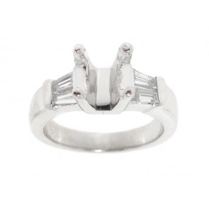 Platinum Engagement Ring with Baguettes